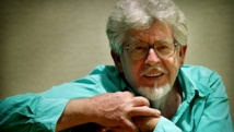 Entertainer Rolf Harris charged with sex assaults in UK
