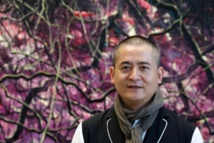Record-breaking Chinese artist Zeng lifts the mask