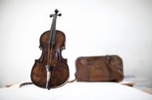 Titanic violin sold for world record $1.4 million