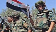 Syria army retakes town near Damascus from rebels