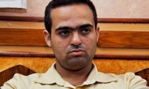 Egypt activist wanted for trial caught in NGO raid