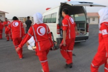 Red Crescent delivers aid to Homs despite coming under attack