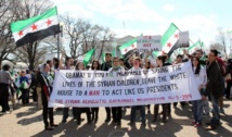 Thousands march in Western capitals to support Syrians