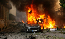 Twin car bombs kill 25 in Syria's Homs: state media