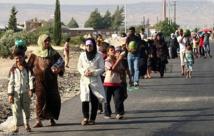 Syrian refugees arrive in new Jordan camp