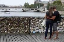 'Locks of love' Paris bridge reopens after railing collapse