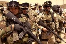 Iraq sacks top officers as UN warns of break-up