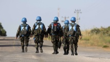 Syria army, rebels clash as UN bids to free Golan monitors