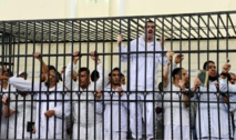 Egypt's Morsi, 100 others sentenced to death