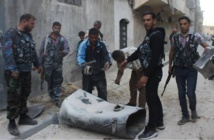 Barrel bombs kill 11 civilians in IS town in Syria