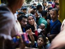 'Inhumane' Austrian refugee camp halts intake