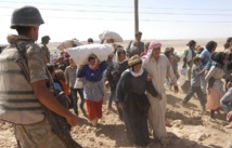 Tens of thousands flee new Syria offensives