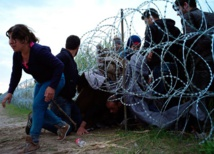 Disillusioned young Poles lend refugees a helping hand