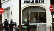 Charlie Hebdo marks anniversary edition with gun-wielding God