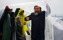 Ai Weiwei brings white grand piano to muddy refugee field