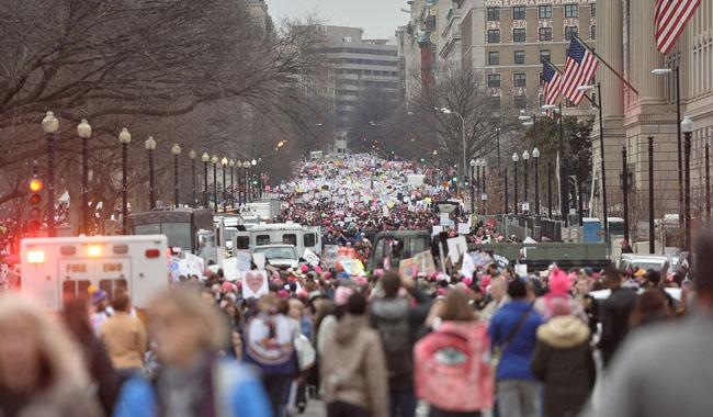 Women's marches draw millions in resistance to Trump