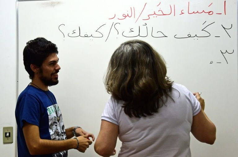 Refugees-turned-language teachers learn new life
