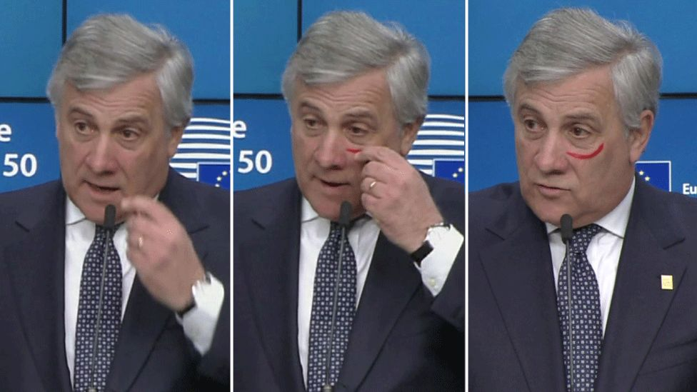 EU's Antonio Tajani sports red make-up for anti-violence campaign