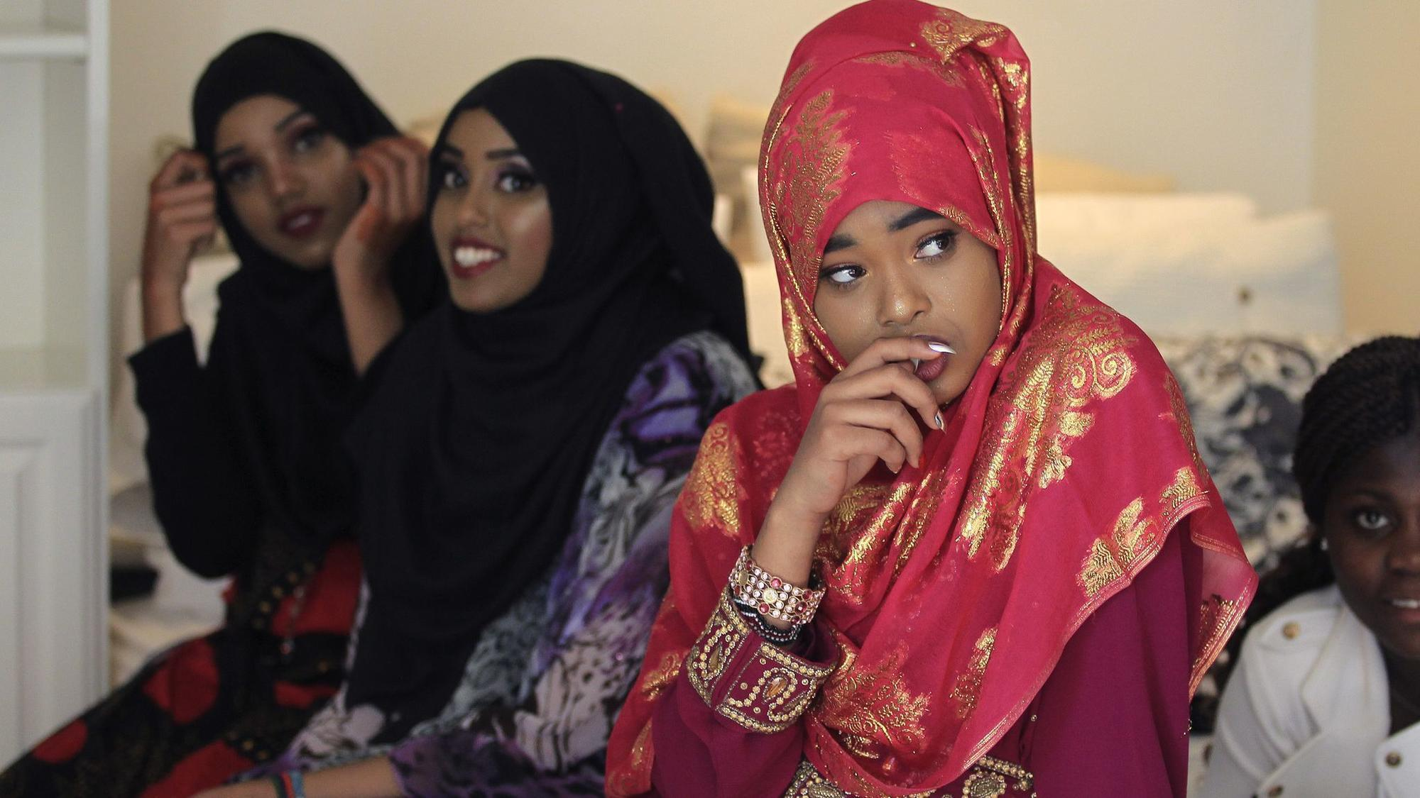 Refugee girls let their cultures shine through in fashion show