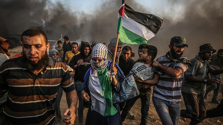 Palestinian and Israeli forces clash during Nakba Day demonstrations