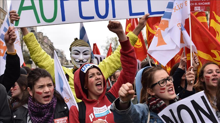 Tens of thousands join French protests against domestic violence