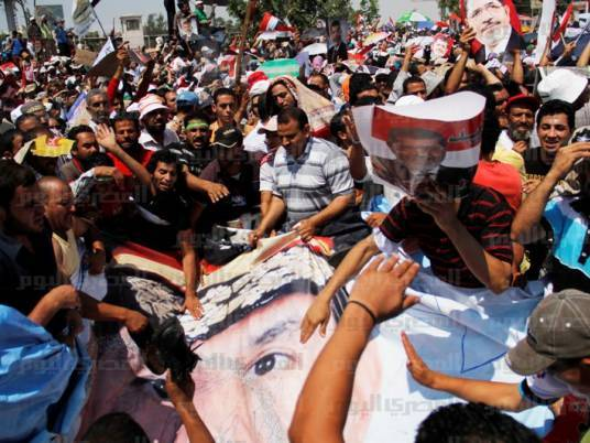 Two die in Cairo clashes between Morsi backers, opponents