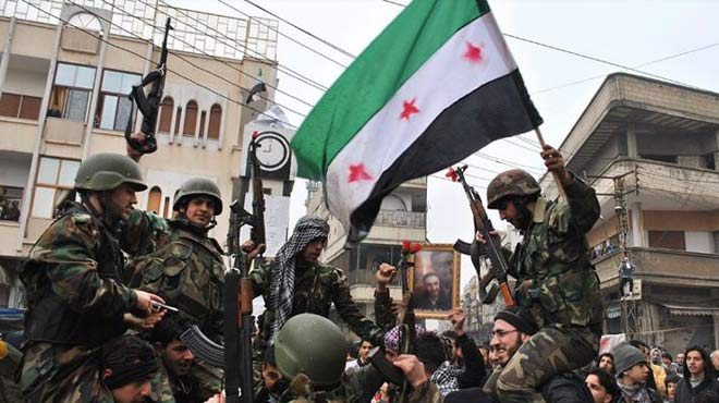24 killed as rebels fight to take Syria border post