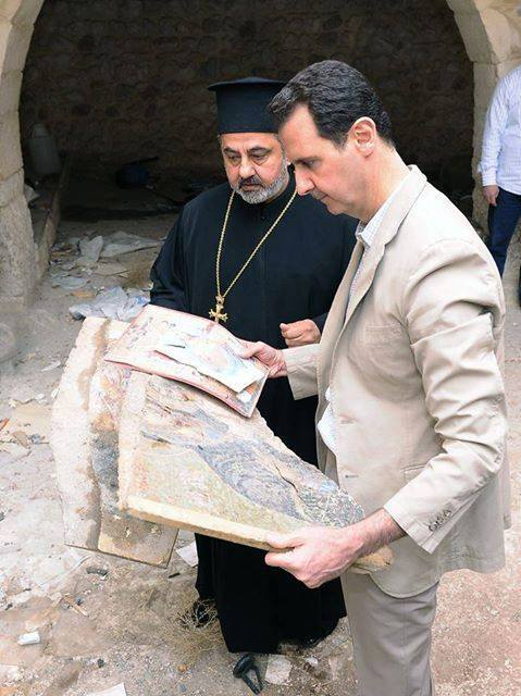 Syria's Assad pays Easter visit to old Christian town