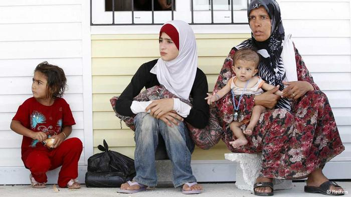 Turkey calls for help with Syria refugees as tensions rise