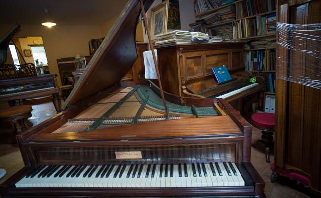 Eccentric French collector turns home into piano 'orphanage'