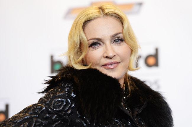 Madonna closes Coachella festival with wet-kiss surprise