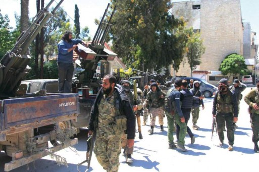 Syrian troops battle to free trapped forces: monitor
