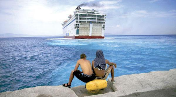 Syrian refugees register on Greek ship docked at Kos