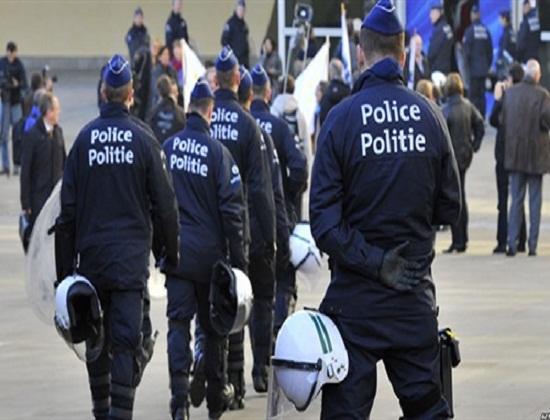 Belgium weighs extending lockdown as police hunt Paris attackers