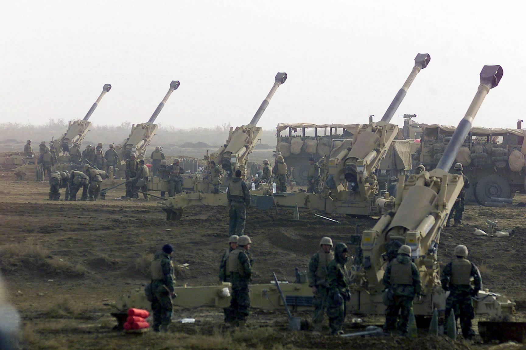 Turkey strikes Kurd, regime forces , mulls ground attack