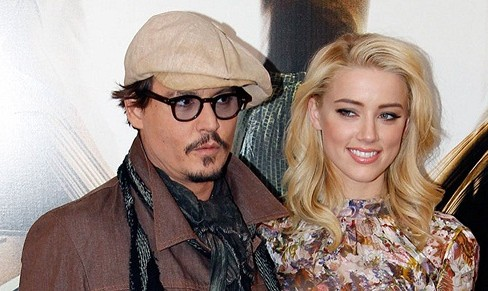 Johnny Depp ordered to stay away from wife over abuse claim