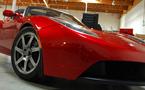 Tesla to unveil electric 5-seat sedan next week