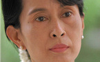 Myanmar to charge Suu Kyi over American's visit