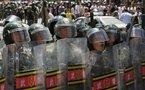 Thousands flee China's restive Urumqi