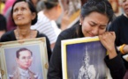 Thai man detained for planning to wear red on late king's funeral day