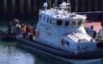 British police detain scores of cross-Channel migrants