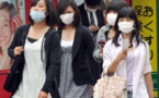 Summer heat prompts Japanese authorities to advise removal of masks