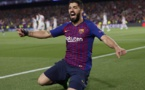 uarez return boosts Barcelona's delayed title bid
