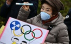 Delayed Tokyo Olympics should be held 'at any cost,' minister says