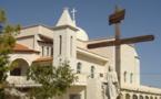 Muslims, Catholics pray over priest's 'barbaric' murder